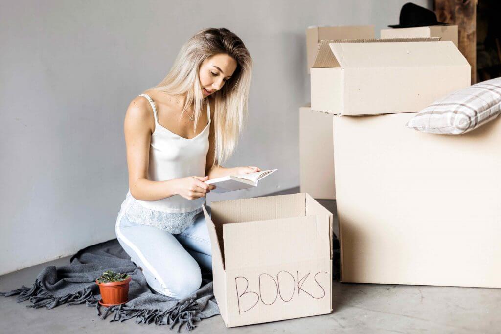 Girl Packing Books