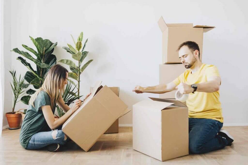 man & women packing box